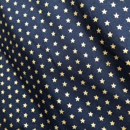Tissu bleu etoiles OR larg 140 cm